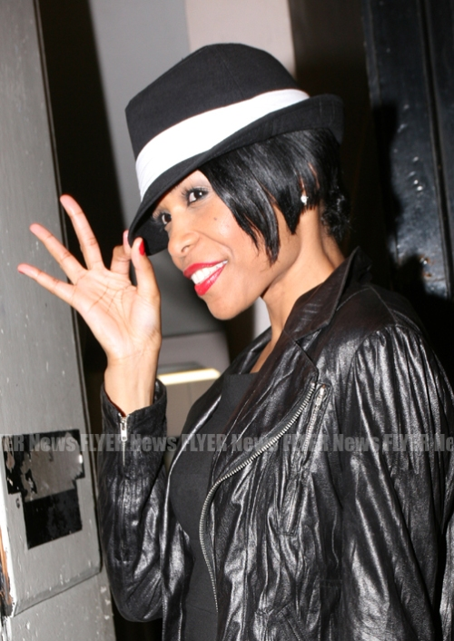 Michelle Williams tipping hat